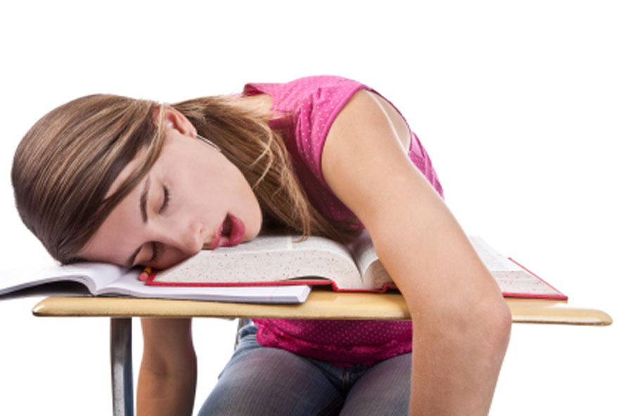 A student fast asleep on her school work.
